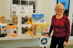 Nancy Wozniak thanks club members for their generous donations of supplies for SMART