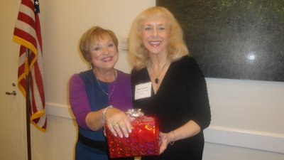 Patti Wrobel, Past President and Monika Templeman, Vice President, receive recognition at January Meeting