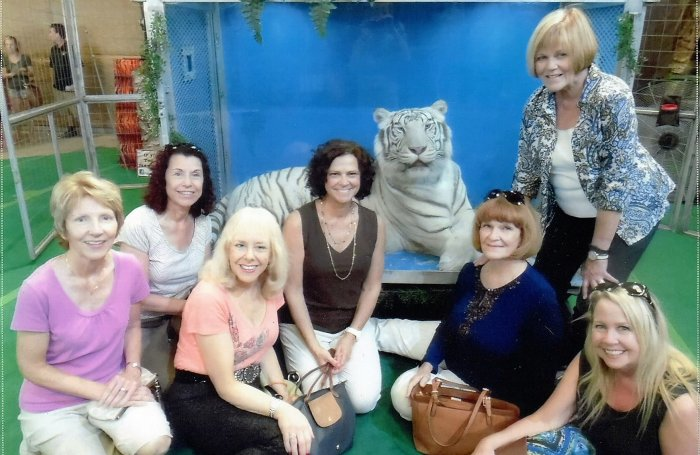 "LWRWC members at Big Cat Habitat and Gulf Coast Sanctuary in Sarasota, a Non-Profit Organization offering a permanent safe haven for mistreated, unwanted and endangered exotic animals. Pictured L-R left to right are Karen Guardino, Phyllis Fox, Monika Templeman, Patti Valenti, ""Barry White"" (beautiful White Tiger), Lenoire  Bredt, Donna Donato, and Carleen Fuiks."