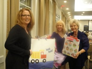 Laurel Lynch [Hope], Monika Templeman and Linda display Birthday Bags