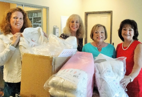 Pictured Left to Right: HOPE's Executive Director, Laurel Lynch, Monika Templeman, LWRWC Publicity Co-Chair, Patti Wrobel, LWRWC President, and Eileen Buzzard, LWRWC Publicity Co-Chair and Philanthropy Committee Member