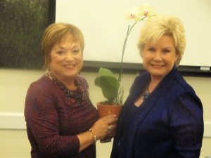 LWRWC president Patti Wrobel gives orchid to Linda Carson