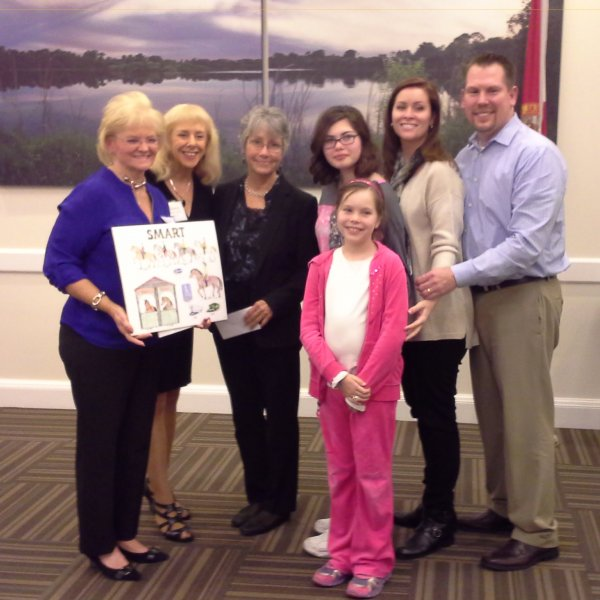 LWRWC Check Presentation to SMART: L-R Nancy Wozniak, Monika Templeman and Gail Clifton and the Martin Family from SMART