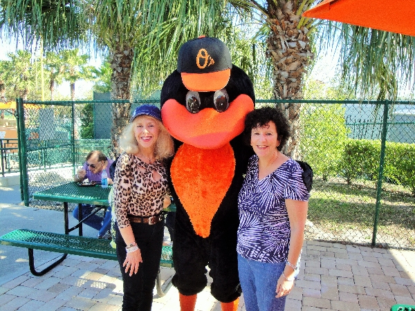 Left to Right: Monika Templeman, LWRWC Publicity Co-Chair, The Oriole Bird,  and Event Chair Helene Levin at the LWRWC pre-game picnic on April 1, 2015
