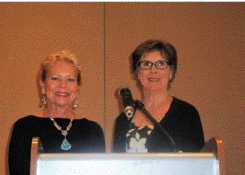 June LeBell and Shirley Taradash at the speaker's podium