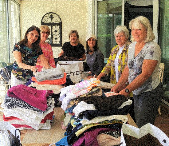 - Lakewood Ranch Women's Club members loading bags of gently used clothing to take to HOPE Family Services.