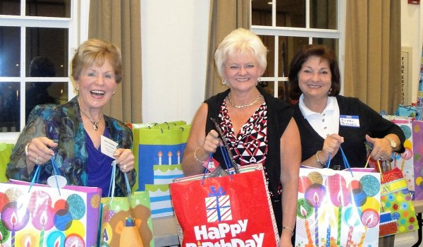 L to R, MaryLee Danahy, Nancy Wozniak, Eileen Buzzard collect Birthday Bags